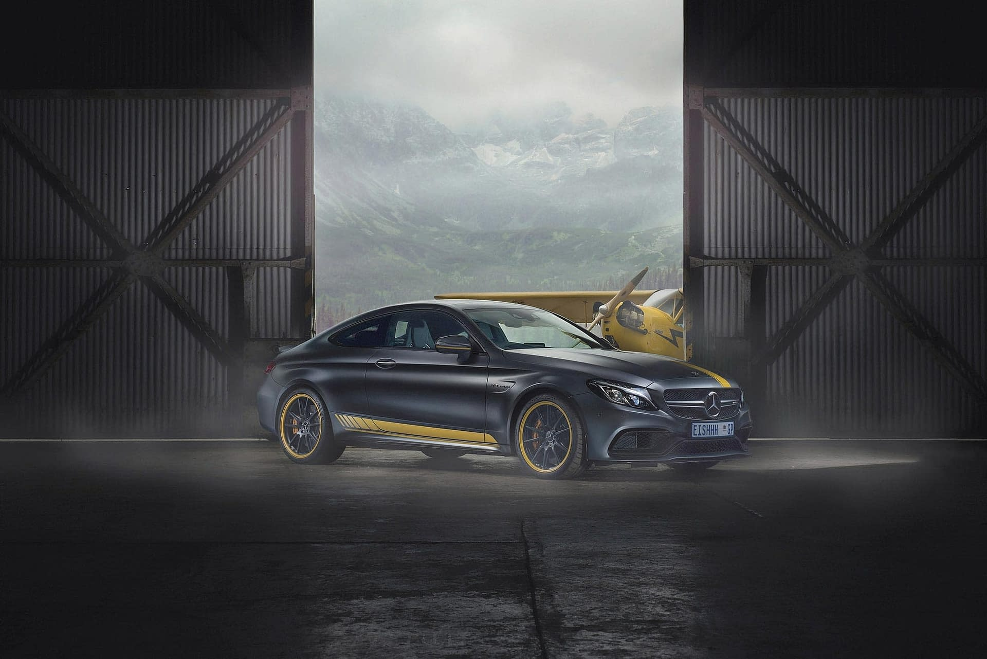 car photography of the mercedes benz amg couple photographed in an aeroplane hanger