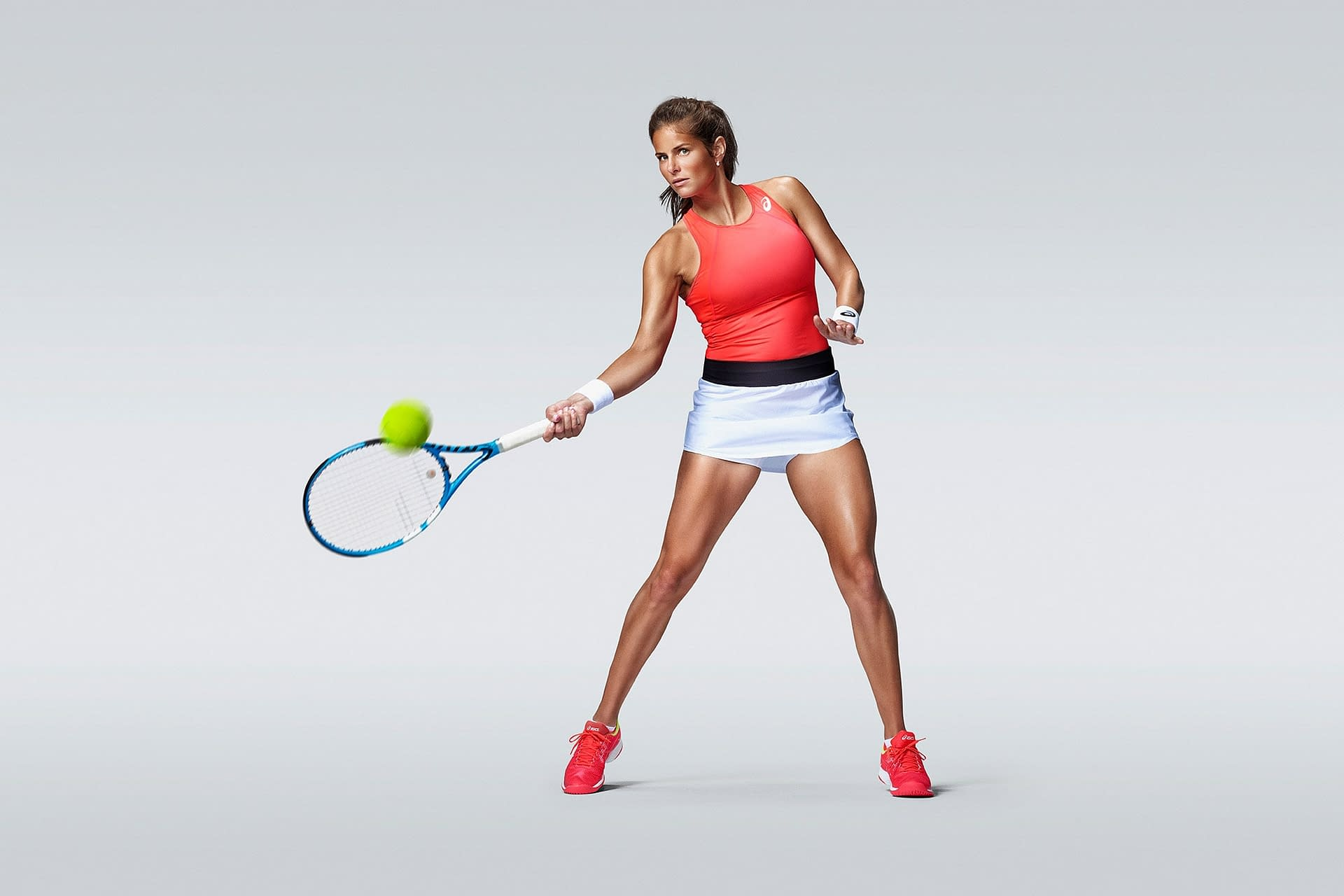 in studio and on location product photo shoot in spain madrid with tennis player julia goerges wearing the asics tennis shoe