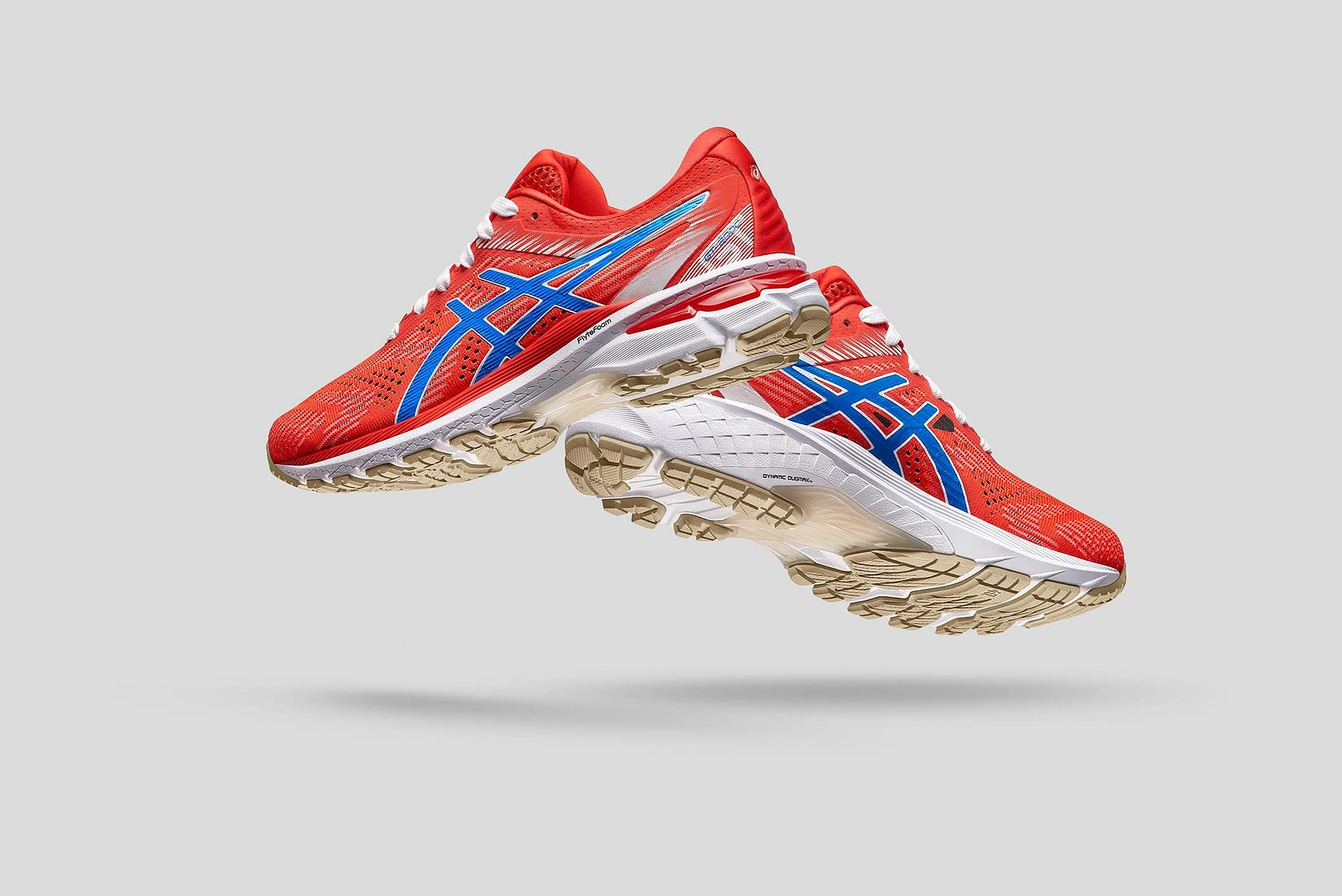 asics gel-kayano long distance running shoes shot in studio shooting tethered to a macbook pro laptop