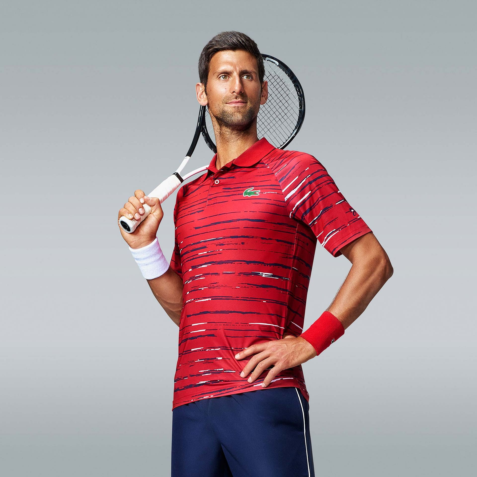 portrait photos of tennis super star novak djokovic in studio using profoto lighting on grey back drop